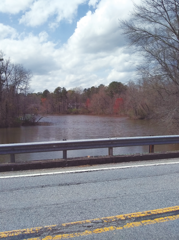 The bridge that carries Willeo Road across Willeo Creek from Fulton County to Cobb County in Georgia is being replaced, but it took some expert surveying to determine the exact county line, which was somewhere in the middle of Willeo Creek. Photo by William Helbig